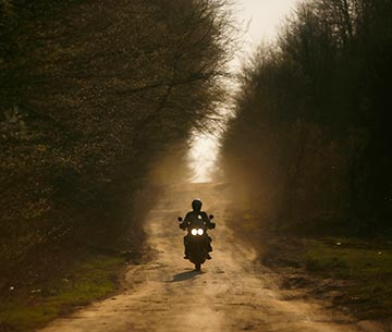 adventure motorcycle rider in forest